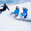Snow splashes from board near two girls — Stock Photo #4373408