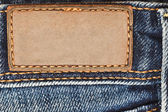 Blank leather label on jeans — Stock Photo