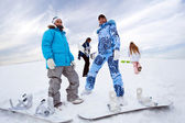Four snowboard riders on hill — Stock Photo