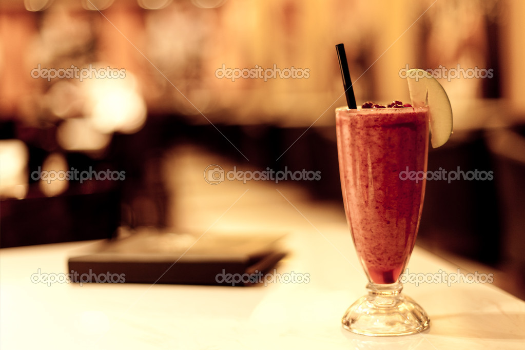 Fruit coctail and menu in night cafe  Stock Photo #4373360