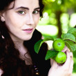 Girl in garden with apples — Stock Photo