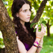 Stock Photo: Girl in park with apples