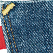 Blue old jeans pocket with empty red label — Stock Photo