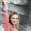 Stock Photo: Portrait of young smiling girl showing gesture V-Victory!