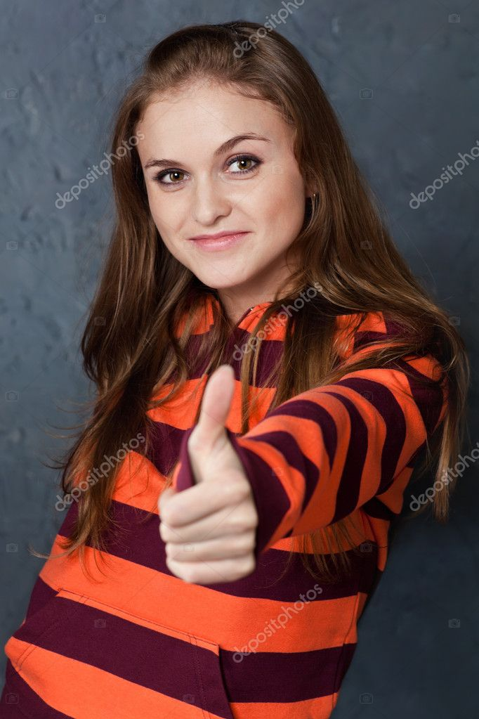 Portrait of young girl showing gesture All right! — Stock Photo #4830789