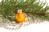Christmas ball and green spruce branch — Stock Photo