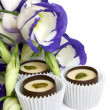 Chocolate sweets with flowers (lisianthus) — Stock Photo