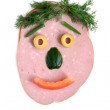 The cut sausage and vegetables in the shape of a happy face - Foto Stock
