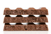 Zásobník porézní čokoláda kusů — Stock fotografie