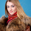 Portrait of beautiful female in sheepskin coat — Stock Photo #5197827