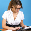 Cute female author with vintage typewriter — Stok fotoğraf
