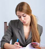 Young female executive reading document — Stock Photo