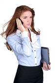 Young female executive talking on cellphone — Stockfoto