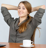 Young business woman relaxing at work — Stock Photo