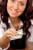 Young woman hand holding one dollar — Stock Photo