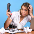 Beautiful businesswoman looking to telephone handset — Stock Photo