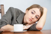 Tired businesswoman looking to the camera — Stock Photo