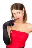 Belle femme en robe rouge avec verre de vin. — Photo