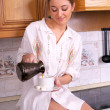Beautiful young female make coffee — Stock Photo #5355753