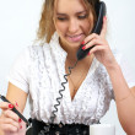 Cute business woman talking phone — Stock Photo #5355797