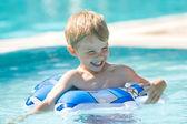 Kid on pool — Stock Photo