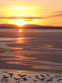 Tramonto sul mar bianco coperto di ghiaccio — Foto Stock