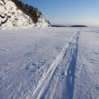 Stock Photo: Trace of snowmobile on ice
