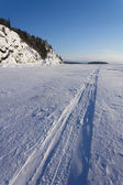 Trace of the snowmobile on the ice — Stok fotoğraf