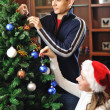 Decorating christmas tree — Stock Photo #3930629