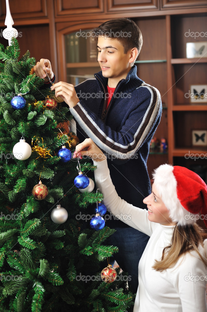 Young couple decorating christmas tree — Stock Photo #3930629