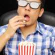 Young man at cinema - Stock Photo