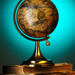 Antique globe on books — Stock Photo #4127396