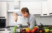 Man in kitchen — Stock Photo