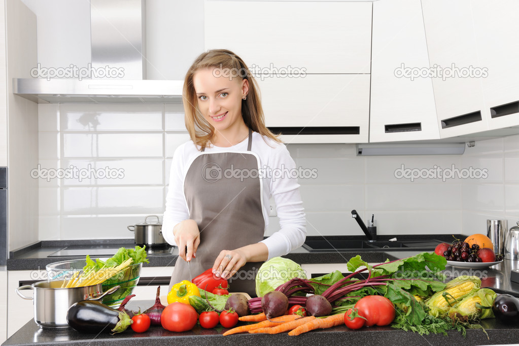 Woman cooking in modern kitchen — Stock Photo #4179340