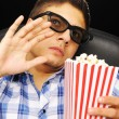 Royalty-Free Stock Photo: Young man at cinema