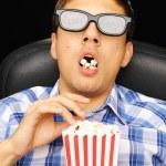 Young man at cinema — Stock Photo