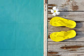 Sandals by a swimming pool — Stock fotografie