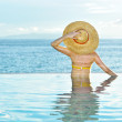 Woman at poolside — Stock Photo #4815695