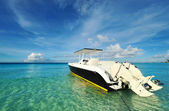 Beautiful beach with motor boat — Stock Photo