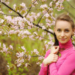 Woman in front of sakura blossoms — Stock Photo #5067360