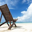 Chaise lounge at beach — Stock Photo #5180863