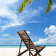 Chaise lounge at beach — Stock Photo #5180886