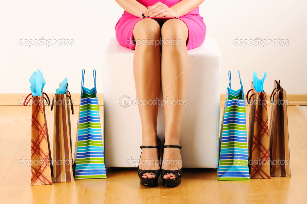 Woman's legs and shopping bags — Stock Photo #5180966