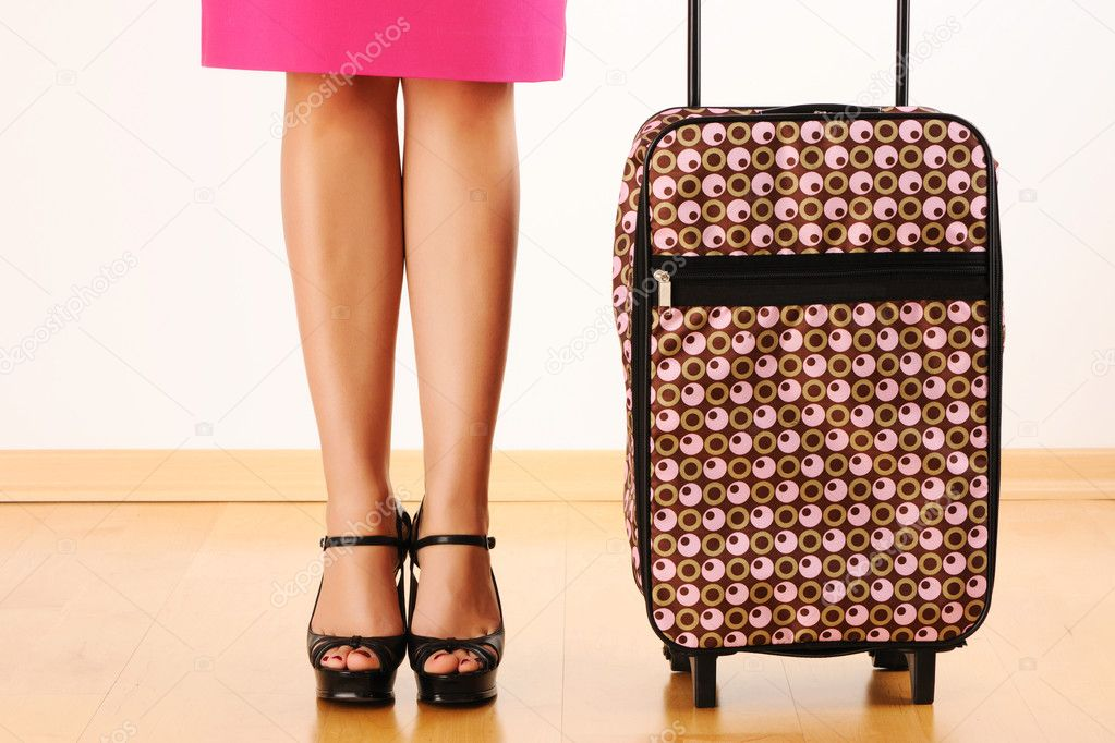 Woman's legs and travel suitcase — Stock Photo #5220220