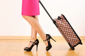 Woman with travel suitcase — Stock Photo
