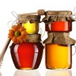 Jars of honey and dipper — Stock Photo