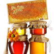 Stock Photo: Jars of honey and dipper