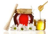Jars of honey and dipper — Stock Photo