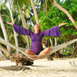 Woman in hammock on beach — Stock Photo