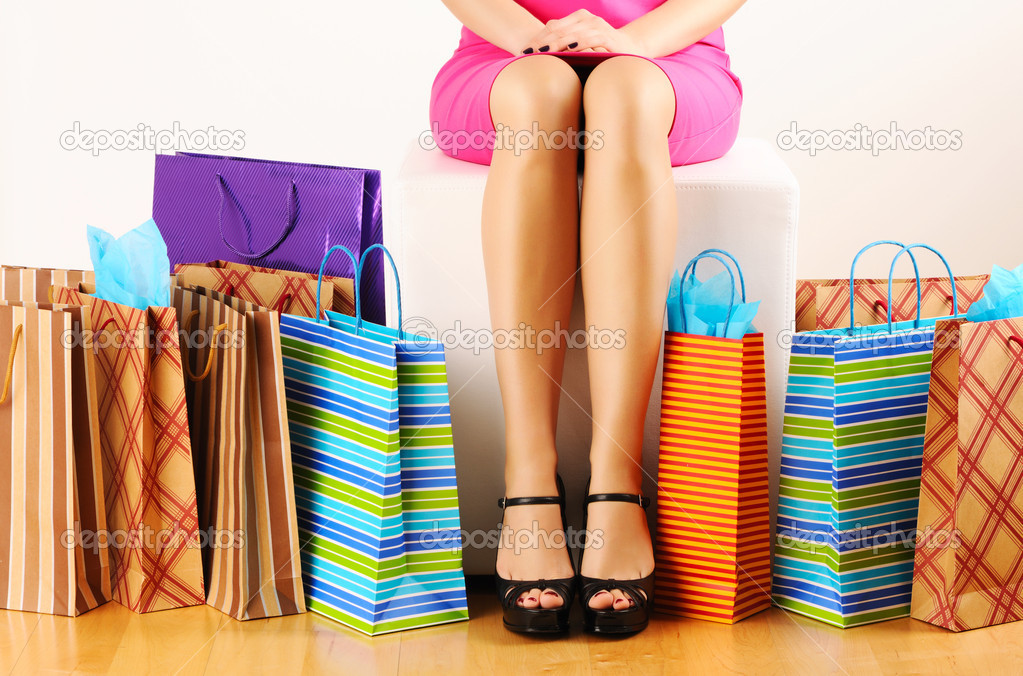 Woman's legs and shopping bags  — Stockfoto #5343020